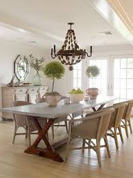 Reclaimed Wood Dining Table With Vintage Cage Chandelier - Wooden dining table with wicker chairs