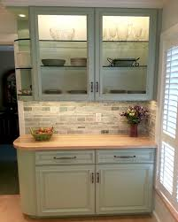 maple countertop blue cabs grey stone backsplash steamy