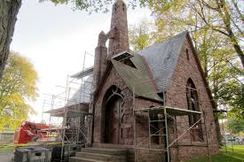 flying buttress restoration of historic hillside cemetery chapel is underway with