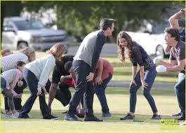 modern family cast plays football for thanksgiving episode photo