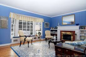 traditional living room with window seat u0026 crown molding in