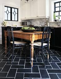 white kitchen cabinets black tile floor farmhouse dining table transitional kitchen
