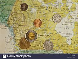 National Map Canadian Coins On National Map Of Canada Still Life Stock Photo