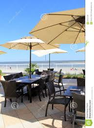 Beach Patio Big Shade Umbrellas Over Dining Tables On Outdoor Patio At The