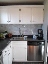 white cabinets with black countertops and backsplash what backsplash looks best with white cabinets and gray