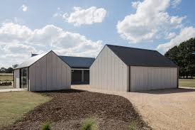modern barn barn outside minimal studio and gallery space inside