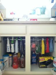 little bit funky use a tension rod to create more storage under little bit funky use a tension rod to create more storage under cabinets