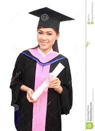graduation gown and cap woman with graduation cap and gown with arm raised stock images