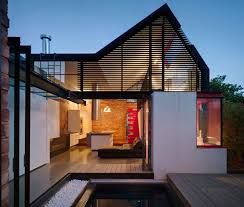 innovative island house with glass facade modern interior design