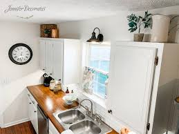 how to paint above kitchen cabinets how to decorate above kitchen cabinets decorates