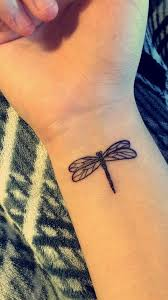 small dragonfly on right wrist