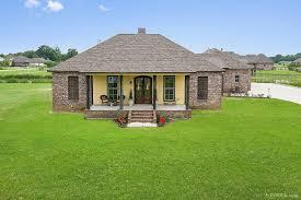 gorgeous custom built acadian style home on acreage 43040 angel