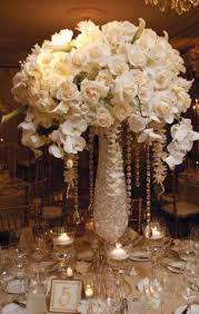tall floral centerpiece with hanging crystals vibrantbride com