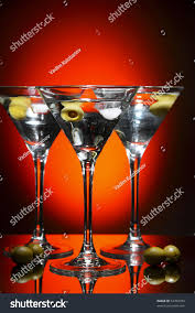 red martini drink martini glass olive inside over red stock photo 53709784