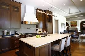 wooden kitchen cabinet with white countertop white range hood