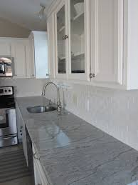White Subway Tile Kitchen by River White Granite White Subway Tile Coastal Living