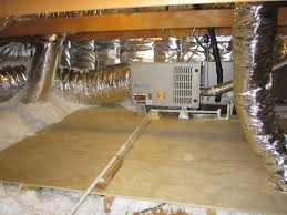 view of a furnace moved to the attic storage platform built and