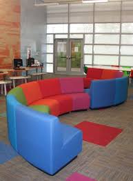 comfy library chairs purple seating claremont high school demco interiors