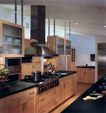 black counters with range hood kitchen transitional and high