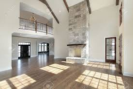 huge great room with stone fireplace and balcony stock photo