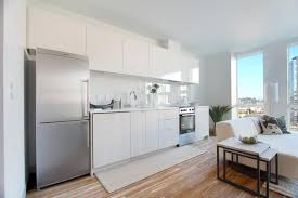 white brick kitchen wall brown wooden chairs apartment kitchen