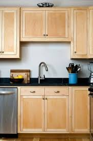 clear coat for cabinets clear coat maple craftsman kitchen with black marble countertop