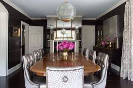 dining room with floor to ceiling antiqued mirrored accent wall