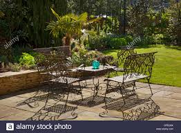 french style metal table and chairs furniture on stone patio in