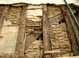 17th century english building exposed wall shows plaster u0026 lath