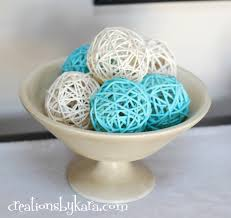 decorating white and blue decorative orbs on wheat bowl for table