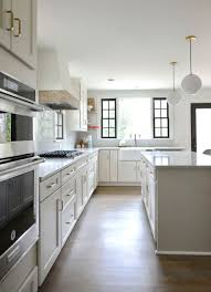 what color kitchen cabinets go with agreeable gray walls the neutral agreeable gray sw cabinets shaker