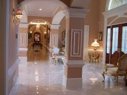 traditional hallway with wall sconce u0026 simple marble tile floors