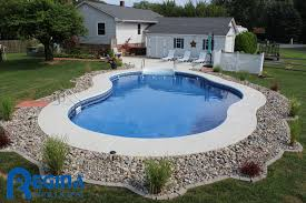 mountain pond shaped vinyl liner swimming pool located in bel air
