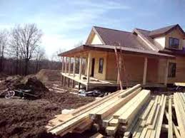 coventy log home competed dry in wrap around porch with metal roof