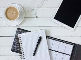 who writes white papers free stock photos of paper pexels black pen on white writing spring notebook between white ipad and white ceramic mug with latte