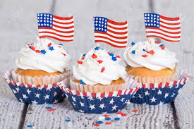 Dessert Flags Patriotic Cupcakes With Sprinkles And American Flags On Vintage