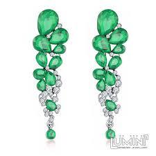 dangler earrings lumini set of dangler earrings and bracelet green