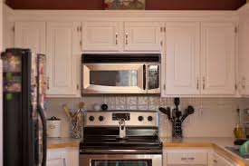 How To Paint Wooden Kitchen Cabinets Repainting Kitchen Cabinets For Old Cabinets On Your Kitchen