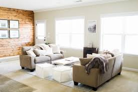 looks cozy and natural with earth tone living room wooden window