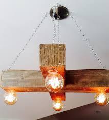 wood beam light fixture barn beam repurposed into barn chandelier homejelly