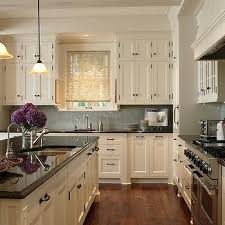 granite countertops for ivory cabinets ivory kitchen cabinets with gray countertops design ideas