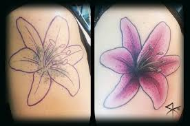 cool lily flower cover up tattoo design for shoulder