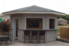 cabana pool house 5 sided shed pool house cabana featuring stucco exterior and garage