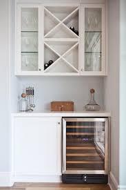 stacked wine racks over mini glass door wine fridge transitional