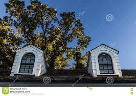 dormers on a black shingle roof stock photo image 77368394