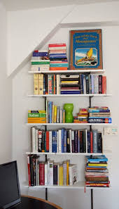 space saver swap out bookcases for built in shelving apartment