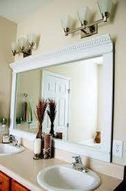 vanity with mirrors crown molding wood around mirror in bathroom
