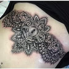 black and grey sternum tattoo by ryan ashley malarkey