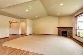 open floor plan empty living room with fireplace and carpet