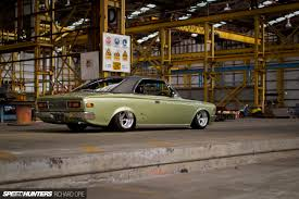 stanced toyota corolla crowning around in a slammed 1960s toyota speedhunters